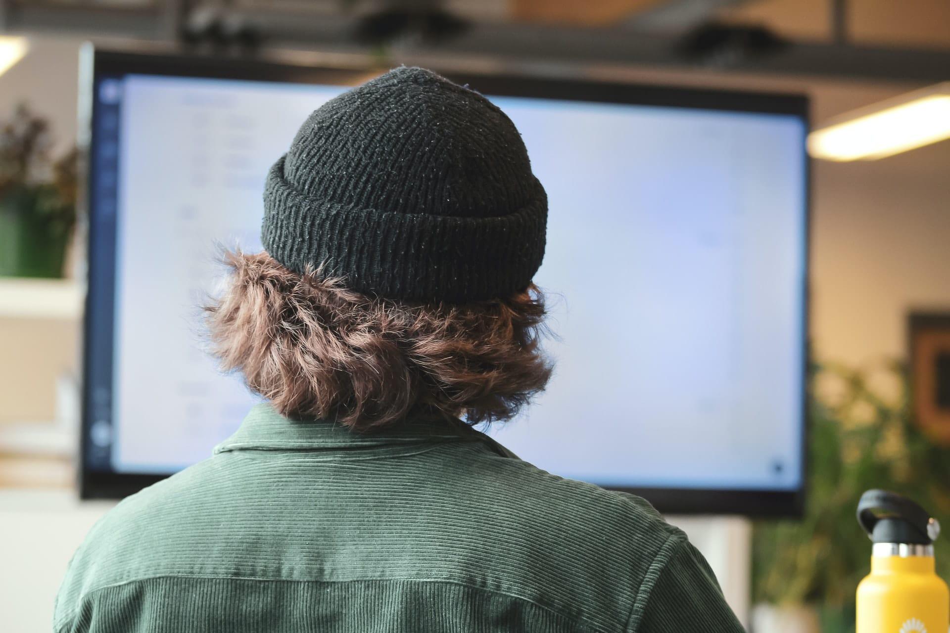 Man looking at monitor