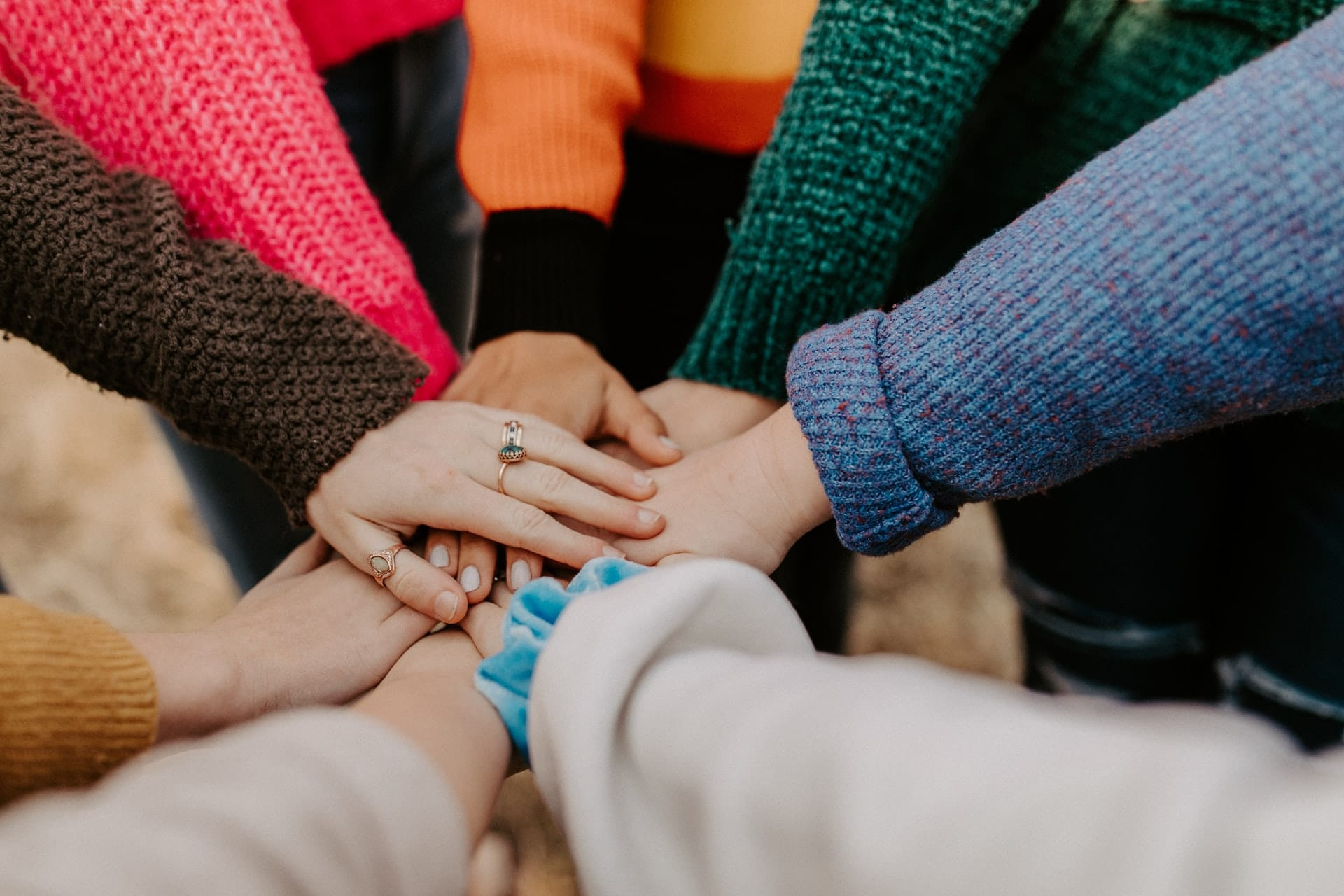 OpenAthens Federation. Hands in a circle showing community and inclusion.